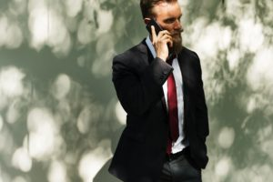 Image of a businessman on his mobile