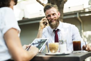 Image of a businessman smiling while on the phone