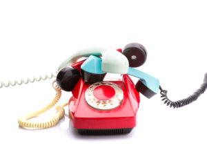 Set of vintage telephone with many handsets