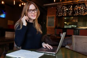 Businesswoman on the phone with laptop open